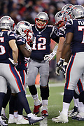 New England Patriots quarterback Tom Brady (12) calls out in the offensive huddle during the fourth quarter of the AFC Championship NFL playoff football game against the Jacksonville Jaguars Patriots, Sunday, Jan. 21, 2018 in Foxborough, Mass. The Patriots won the game 24-20. (©Paul Anthony Spinelli)