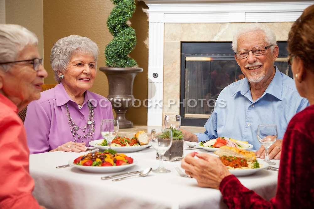 Retired Couple and Friends Enjoying Dinner Together