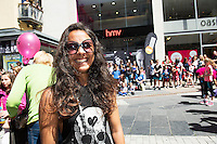 Hannah King, Westport with one of the break dancers at the opening of HMV Galwayat Edward square. Photo:Andrew Downes