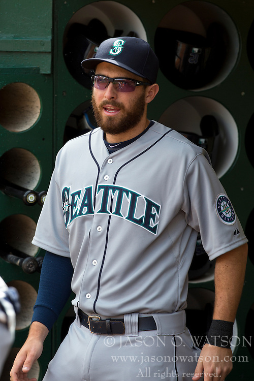 OAKLAND, CA - APRIL 04: Dustin Ackley #13 of the Seattle Mariners stands in the dugout before the game against the Oakland Athletics at O.co Coliseum on April 4, 2013 in Oakland, California.  The Oakland Athletics defeated the Seattle Mariners 8-2. (Photo by Jason O. Watson/Getty Images) *** Local Caption *** Dustin Ackley