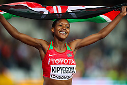 London, 2017 August 07. Faith Chepngetich Kipyegon, Kenya, celebrates her world championship winning women's 1,500m final on day four of the IAAF London 2017 world Championships at the London Stadium. © Paul Davey.