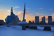 Canadian Museum for Human Rights (CMHR) and the Esplanade Riel Bridge in winter<br /> Winnipeg<br /> Manitoba<br /> Canada