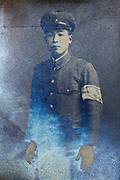 silver mirroring on a vintage portrait of a young adult man wearing a school uniform Japan
