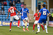 Gillingham forward Ben Dickenson and Coventry midfielder Gaël Bigirimana during the Sky Bet League 1 match between Gillingham and Coventry City at the MEMS Priestfield Stadium, Gillingham, England on 2 April 2016. Photo by David Charbit.