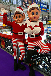 Two elves have a rest at  the Toy Fair at Kensington Olympia in London, the UK's largest dedicated game and hobby exhibition featuring the hottest and most anticipated products for the year ahead. London, January 22 2019.