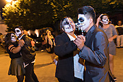 Students dressed as skeletons dance during the Day of the Dead festival in the Plaza Civica October 28, 2016 in San Miguel de Allende, Guanajuato, Mexico. The week-long celebration is a time when Mexicans welcome the dead back to earth for a visit and celebrate life.