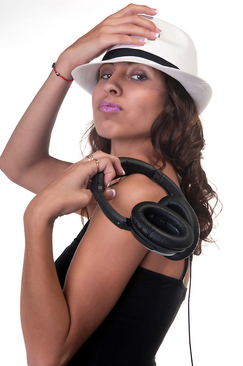Portrait of hispanic girl listening music with headphones.