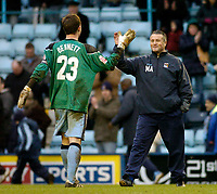 Photo. Glyn Thomas. 22/02/2005.<br /> Coventry City v Stoke City. Coca Cola Championship.<br /> Coventry manger Micky Adams (R) congratulates stand-in keeper Stephen Hughes on a superb display following the sending-off of Ian Bennett.