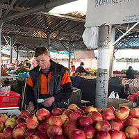 TIMISOARA, ROMANIA - APRIL 21:  A farmer sells Romanian apples from his stall at the daily market on April 21, 2013 in Timisoara, Romania.  Romania has abandoned a target deadline of 2015 to switch to the single European currency and will now submit to the European Commission a programme on progress towards the adoption of the Euro, which for the first time will not have a target date. (Photo by Marco Secchi/Getty Images)