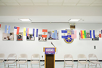 """17 October, 2008. New York, NY. A lecturn, empty chairs and flags are here minutes before the """"Latinos for Obama"""" press conference at the Local 237 Teamster of 14th street in Manhattan, NY. Then Latino Obama supporters and volunteers will gather for spanish phone banking in key states. Teamster is one of the largest labor unions of the country a photo auction fundraising show in Williamsburg, Brooklyn. The Obama volunteers in New York have been helping the campaign for weeks organizing phone banking, fund raisings, canvas, concerts, fashion shows, etc.<br /> <br /> <br /> ©2008 Gianni Cipriano for The New York Times<br /> cell. +1 646 465 2168 (USA)<br /> cell. +1 328 567 7923 (Italy)<br /> gianni@giannicipriano.com<br /> www.giannicipriano.com"""