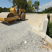 Ryan Rodgers, with Cademy Contracting, drives a roller as he packs the gravel drive at The Hive just off of Highway 278 in Lee County.