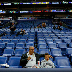 Feb 7, 2018; New Orleans, LA, USA; New Orleans Pelicans fans sit nearly along in the stand after an announcement that a game between the New Orleans Pelicans and the Indiana Pacers was postponed after a nearly two hour delay due to a roof leak at the Smoothie King Center. Mandatory Credit: Derick E. Hingle-USA TODAY Sports