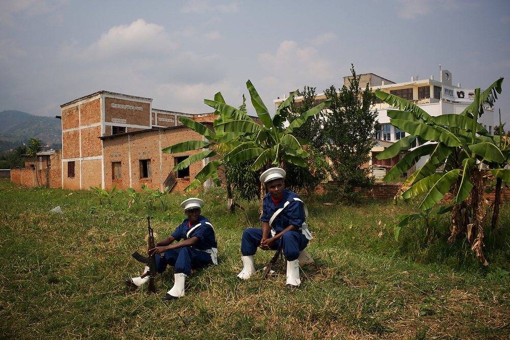 Burundi National Policemen soldiers rest outside Prince Rwagasore Stadium in Bujumbura after a rehearsal for the celebrations of the Country 53rd Independence Anniversary.