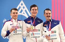 Great Britian's Chris O'Hare (left), Norway's Jakob Ingebrigtsen and Henrik Ingebrigtsen celebrates with their medels in the Men's 3000m final during day two of the European Indoor Athletics Championships at the Emirates Arena, Glasgow.