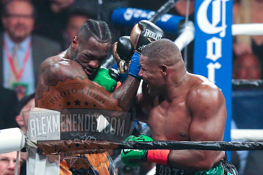 Luis Ortiz (r) lands a shot to the chin of Deontay Wilder during the WBC Heavyweight Championship boxing match at Barclays Center on Saturday, March 3, 2018 in Brooklyn, New York. Wilder would win the bout by knockout in the tenth round to retain the title and move to 40-0. (Alex Menendez via AP)