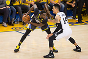 Golden State Warriors forward Draymond Green (23) handles the ball against the San Antonio Spurs during Game 2 of the Western Conference Quarterfinals at Oracle Arena in Oakland, Calif., on April 16, 2018. (Stan Olszewski/Special to S.F. Examiner)
