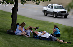 June 21, 2017 - Flint, Michigan, U.S. - NICK MAHONEY of Atlanta, center rests in the shade by the side of the road with other passengers waiting for clearance to go back inside Bishop International Airport. A police officer was stabbed at the airport earlier in the day and the airport evacuated. (Credit Image: © Detroit Free Press via ZUMA Wire)