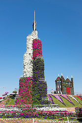 Model of Burj Khalifa tower covered in flowers at  Miracle Garden the world's biggest flower garden in Dubai United Arab Emirates
