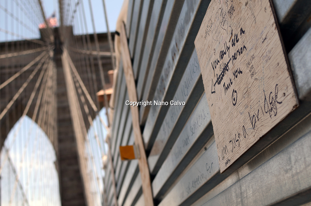 "Wood plaque that reads ""Im Just a Bridge"", on Brooklyn Bridge, New York"