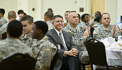 President Thomas Krise surrounded by soldiers from JBLM at a Thanksgiving dinner held in Chris Knutzen hall of the Anderson University center on Wednesday, Nov. 26, 2014. (Photo/John Froschauer)