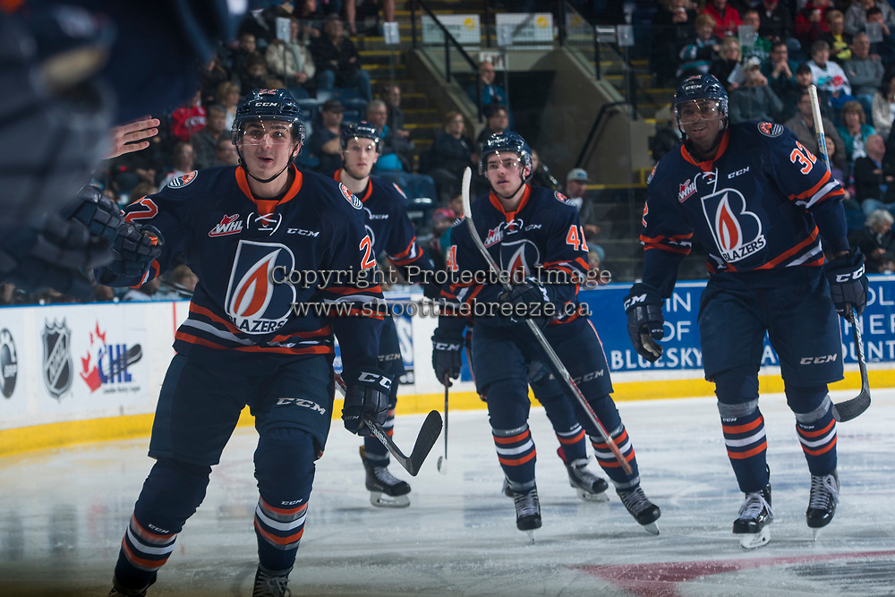 KELOWNA, CANADA - MARCH 31: Dallas Valentine #6,  Garrett Pilon #41, Quinn  Benjafield #22 and Jermaine Loewen #32 of the Kamloops Blazers skate to the bench to celebrate a goal against the Kelowna Rockets on March 31, 2017 at Prospera Place in Kelowna, British Columbia, Canada.  (Photo by Marissa Baecker/Shoot the Breeze)  *** Local Caption ***