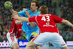 Uros Zorman of Slovenia vs R. Ozechowski of Poland during handball match between National teams of Slovenia and Poland of Qualifications for EURO 2012, on March 9, 2011 in Arena Stozice, Ljubljana, Slovenia. Slovenia defeated Poland 30-28. (Photo By Vid Ponikvar / Sportida.com)