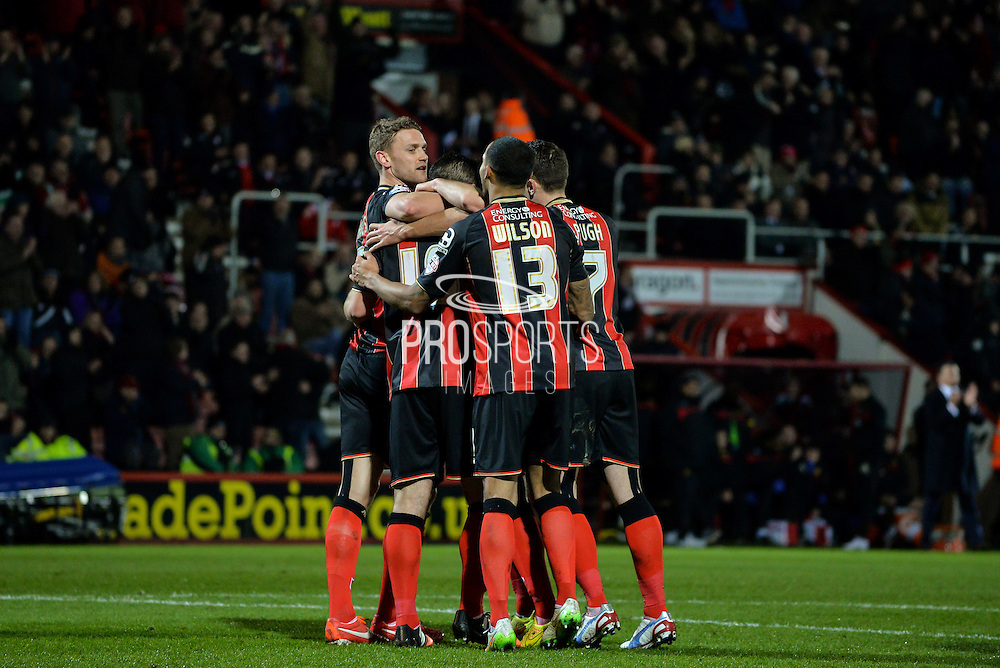 Bournemouth players celebrate Yann Kermorgant goal during the Sky Bet Championship match between Bournemouth and Watford at the Goldsands Stadium, Bournemouth, England on 30 January 2015. Photo by Adam Rivers.
