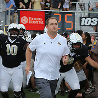 ORLANDO, FL - SEPTEMBER 08:  Head coach Josh Heupel of the UCF Knights lead his team onto the field during a football game against the South Carolina State Bulldogs at Spectrum Stadium on September 8, 2018 in Orlando, Florida. (Photo by Alex Menendez/Getty Images) *** Local Caption *** Josh Heupel