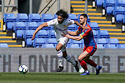 Izzy Brown of Leeds United U23 under pressure during the U23 Professional Development League match between U23 Crystal Palace and Leeds United at Selhurst Park, London, England on 15 April 2019.