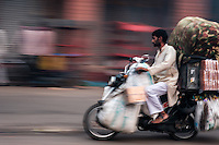 NEW DELHI, INDIA - CIRCA OCTOBER 2016: Man in motorbike in the streets of Delhi carrying goods.