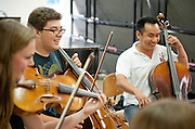 Steven Huang, right, helps a chamber group rehearse during a master class in Ohio Univertsity's Mozart on the Green Chamber Music Festival and Academy on August 9, 2012 in Athens, Ohio.