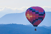 A hot air balloon flying over the Rocky Mountains