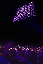 © Licensed to London News Pictures. 08/08/2015. Cornbury Park, Charlbury, Oxfordshire. The Saturday night Spectacle - the 48 person human net was suspended 75 feet above the crowd. The Wilderness Festival 2015 at Cornbury Park in Oxfordshire. Photo credit : MARK HEMSWORTH/LNP