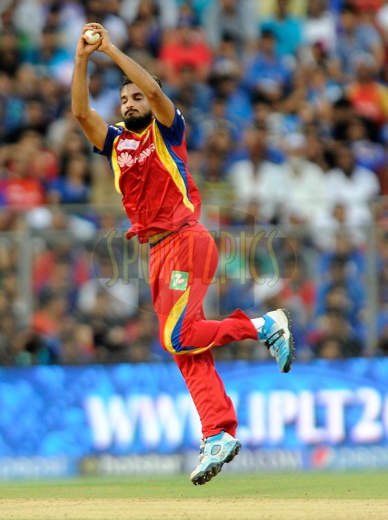 Harshal Patel of Royal Challengers Bangalore fields of his own bowling during match 46 of the Pepsi IPL 2015 (Indian Premier League) between The Mumbai Indians and The Royal Challengers Bangalore held at the Wankhede Stadium in Mumbai, India on the 10th May 2015.<br /> <br /> Photo by:  Pal Pillai / SPORTZPICS / IPL