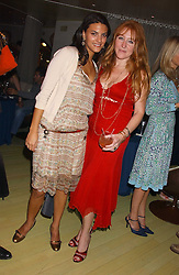 Left to right, FRANCESCA BUSNELLI and CHARLOTTE TILBURY at a fashion show by ISSA held at Cocoon, 65 Regent Street, London on 21st September 2005.<br />
