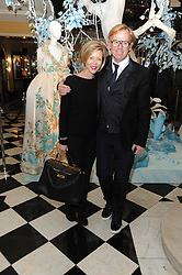 REBECCA CARCELLE and DAVID COLLINS at the launch of the Claridge's Christmas Tree designed by John Galliano for Dior held at Claridge's, Brook Street, London on 1st December 2009.