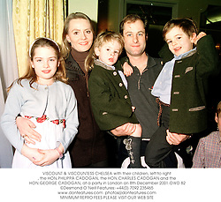 VISCOUNT & VISCOUNTESS CHELSEA with their children, left to right, the HON.PHILIPPA CADOGAN, the HON.CHARLES CADOGAN and the HON.GEORGE CADOGAN, at a party in London on 8th December 2001.OWD 82