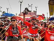06 APRIL 2014 - BANGKOK, THAILAND: Red Shirt entertainers dance at a Red Shirt rally in the Bangkok suburbs Sunday. Red Shirts and supporters of the government of Yingluck Shinawatra, the Prime Minister of Thailand, gathered in a suburb of Bangkok this weekend to show support for the government. The Thai government is dealing with ongoing protests led by anti-government activists. Legal challenges filed by critics of the government could bring the government down as soon as the end of April. The Red Shirt rally this weekend was to show support for the government, which public opinion polls show still has the support of most of the electorate.   PHOTO BY JACK KURTZ
