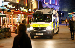 """© Licensed to London News Pictures. 24/02/2016. London, UK. Police at the scene of a """"hostage situation"""" at Bella Italia restaurant in Leicester Square, London where a man claiming to be in possession of a knife is holding a woman against her will. Metropolitan Police reported the incident is not terrorist-related. Photo credit: Tolga Akmen/LNP"""
