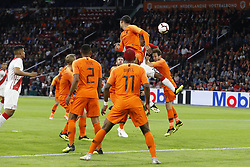 Virgil van Dijk of Holland (C), Pedro Aquino of Peru (CR), Daley Blind of Holland (R) during the International friendly match match between The Netherlands and Peru at the Johan Cruijff Arena on September 06, 2018 in Amsterdam, The Netherlands