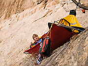 Leo Houlding wakes at the first portaledge camp, Monte Brento