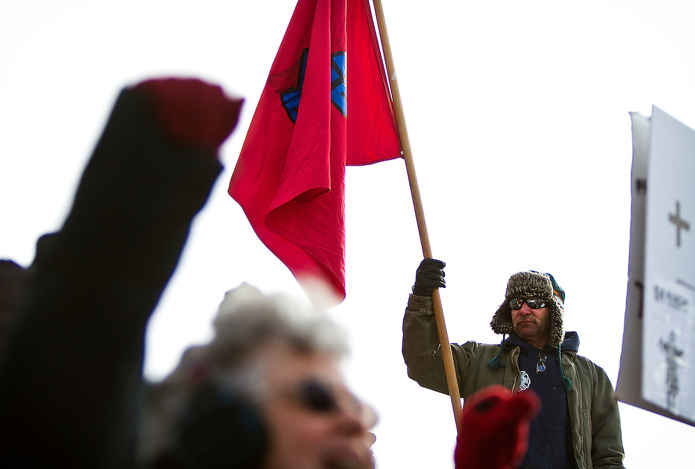 MADISON, WI — FEBRUARY 24: Jim Cerro holds the Solidarity flag aloft outside the Wisconsin State Capitol on Tuesday, February 24. Workers and labor unions rallied in opposition to a right-to-work bill being discussed in the state legislature.