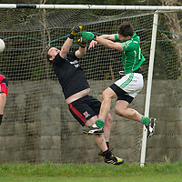 Kilrush Shamrock's Ryan Ellis V Meelick's goalie David Moloney