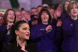 © Licensed to London News Pictures. 01/03/2012. London, UK.  Roger (unknown surname) organised a singing flashmob in Piccadilly Circus tonight (01/03) to propose to his girlfriend Gina (pictured left) with a professional choir of around 100 singers and over 200 'facebook dancers' who sang 'Can't Take My Eyes Off You (I love you baby)' by Frankie Valli. Roger set up a secret event on facebook under the alias 'Romeo' to maintain secrecy. They have been dating for around a year, Gina said yes.  Photo credit : James Gourley/LNP