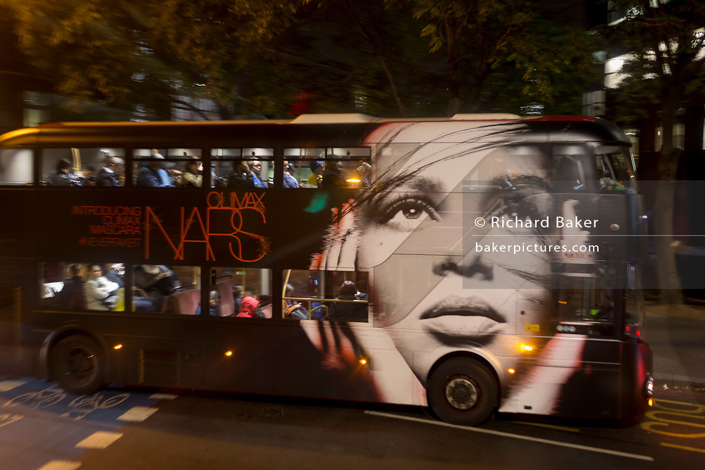 A blurred face for a make-up brand ad on the side of a bus at Elephant & Castle, on 6th November 2018, in London, England.