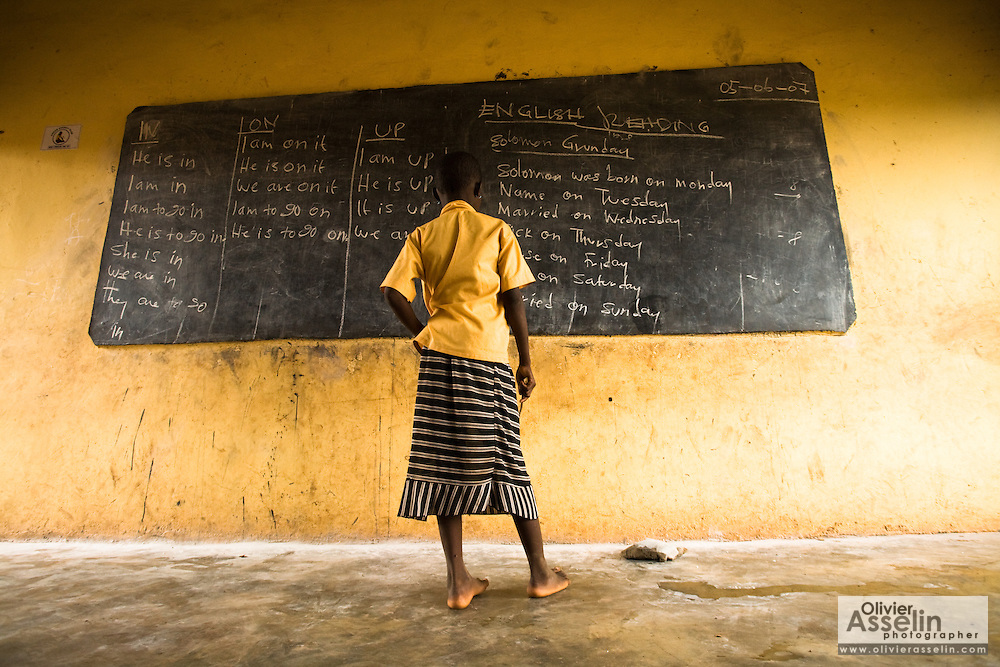 A girl reads text written on a black board during class at the Nyologu Primary School in the village of Nyologu, northern Ghana, on Wednesday June 6, 2007.