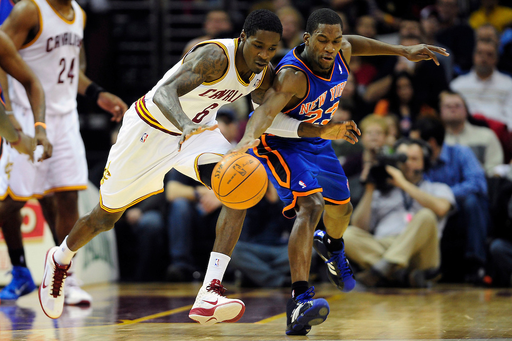 Feb. 25, 2011; Cleveland, OH, USA; Cleveland Cavaliers guard Manny Harris (6) and New York Knicks guard Toney Douglas (23) fight for a loose ball during the second quarter at Quicken Loans Arena. Mandatory Credit: Jason Miller-US PRESSWIRE