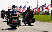 Members of the American Legion pull into the American Legion Post 639 on South Scenic Avenue during the American Legion Legacy Ride on Monday, August 19, 2013. The Legacy Ride features members from across the nation and the United Kingdom. (David Welker/For the News-Leader)