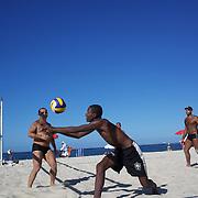 Locals play beach volleyball at Copacabana beach, Rio de Janeiro,  Brazil. 4th July 2010. Photo Tim Clayton....