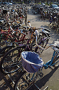 Bicycles parked at train station in Ferrara, Italy.
